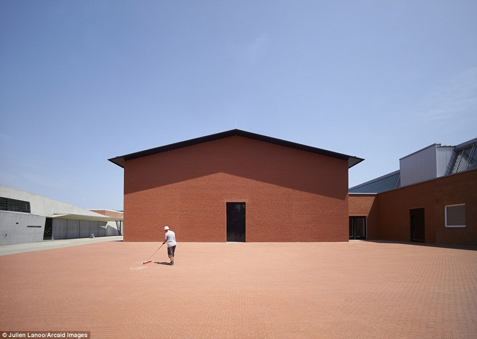 Architect firm Herzog & de Meuron designed this eye-catching museum in Weil am Rhein, Germany Read more: http://www.dailymail.co.uk/travel/travel_news/article-3965280/Building-great-careers-stunning-shortlisted-entries-Architectural-Photography-Awards.html#ixzz4RCYyW7wv Follow us: @MailOnline on Twitter | DailyMail on Facebook