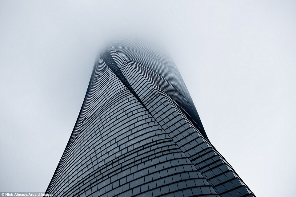 This incredible image of Shanghai Tower in China half covered by clouds wowed the judges Read more: http://www.dailymail.co.uk/travel/travel_news/article-3965280/Building-great-careers-stunning-shortlisted-entries-Architectural-Photography-Awards.html#ixzz4RCYY8Tzn Follow us: @MailOnline on Twitter | DailyMail on Facebook