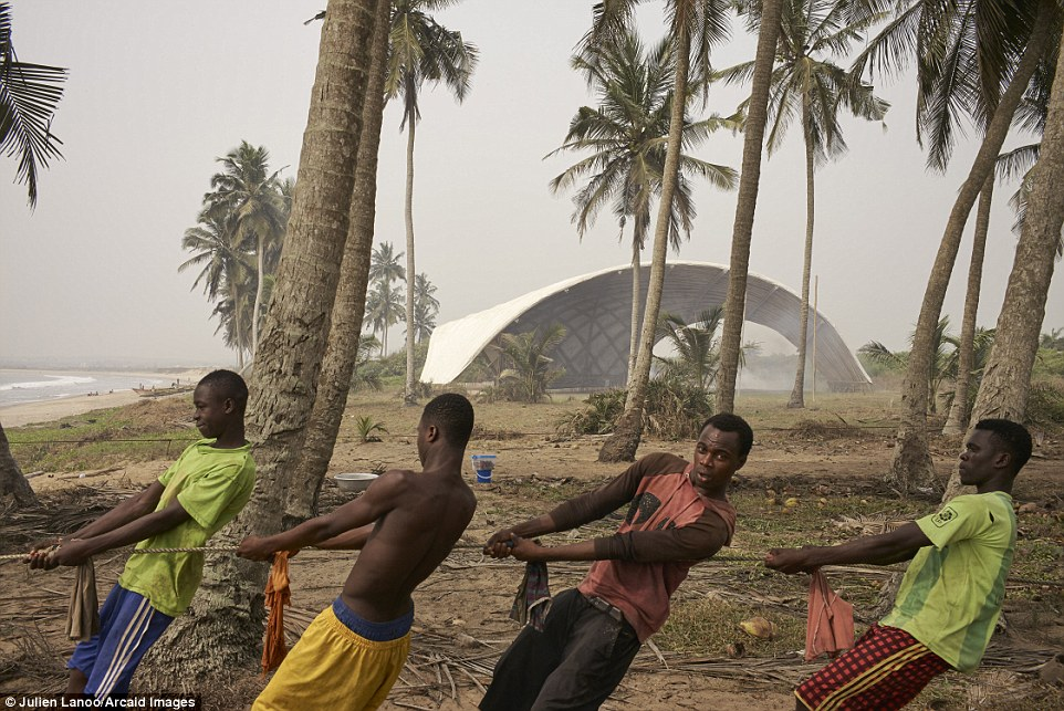Locals are pictured here in an image by Julien Lanoo toiling to erect the stage for the Haduwa Arts & Culture Institute in Ghana Read more: http://www.dailymail.co.uk/travel/travel_news/article-3965280/Building-great-careers-stunning-shortlisted-entries-Architectural-Photography-Awards.html#ixzz4RCZDgWu3 Follow us: @MailOnline on Twitter | DailyMail on Facebook