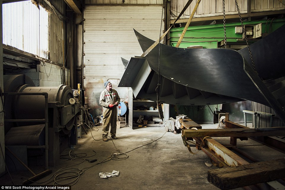 A helical staircase being manufactured in a workshop in Littlehampton, West Sussex Read more: http://www.dailymail.co.uk/travel/travel_news/article-3965280/Building-great-careers-stunning-shortlisted-entries-Architectural-Photography-Awards.html#ixzz4RCZPZGef Follow us: @MailOnline on Twitter | DailyMail on Facebook