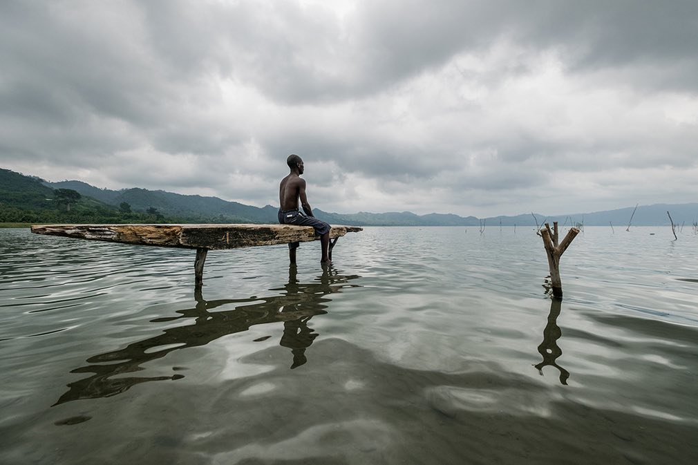 Fisherman at Lake Bosumtwi, Ashanti, Ghana. Tradition dictates that fishing may only be done using wooden planks called paduas – the same method their ancestors used