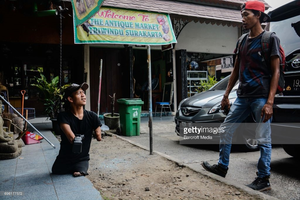 Achmad Zulkarnain during a photo session in Triwindu Market Solo on May 26, 2017 in Central Java, Indonesia. (Sijori Images / Barcroft Images / Barcroft Media via Getty Images)